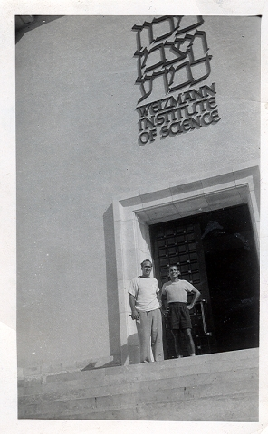 Sy and his uncle in 1949 in front of the Ziskind Building.