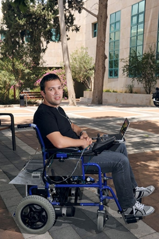 Dr. Anton Plotkin in the lab of Prof. Noam Sobel, testing the sniff-controlled motorized wheelchair.