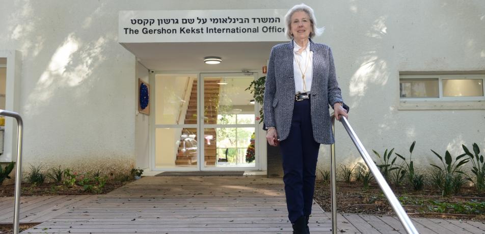 Carol Kekst stands in front of the new Gershon Kekst International Office.
