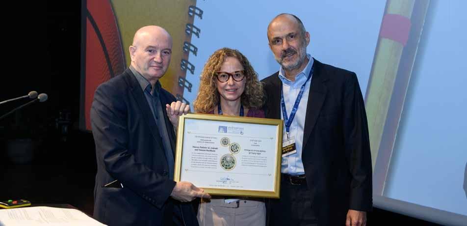 L to R: Former Weizmann President Prof. Daniel Zajfman with Vanessa Buchheim and Marcos Pinheiro de Andrade at last year's Int'l Board