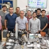 Prof. Victor Malka (fifth from left) in his lab with French colleagues