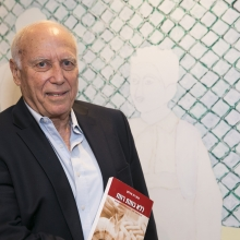 Prof. David Mirelman holding the book's Hebrew edition
