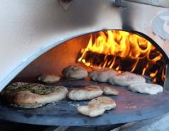 Making pita bread in the taboon
